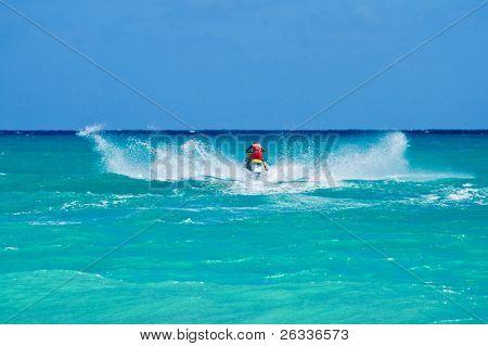 Man riding jet ski in Caribbean sea