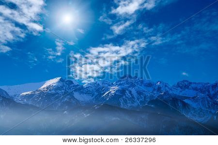 Remote mountains (The Tatras in Poland) above clouds