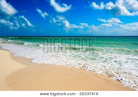 Beautiful beach and  waves of Caribbean Sea