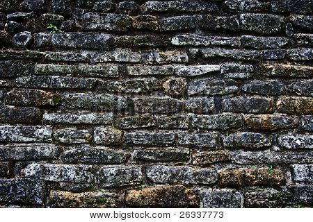 Ancient stone wall of Mayan building in Palenke, Mexico,