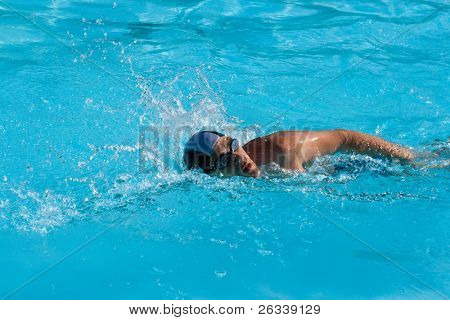 Athletic man swimmer swimming in pool