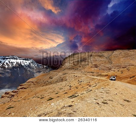 Road in mountains (Himalayas) with car. Spiti Valley,  Himachal Pradesh, India