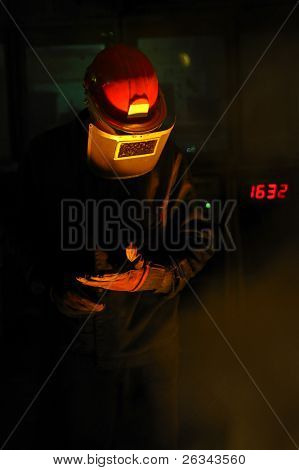 worker with hot steel