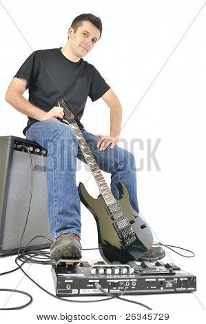 Young with guitar and an amplifier