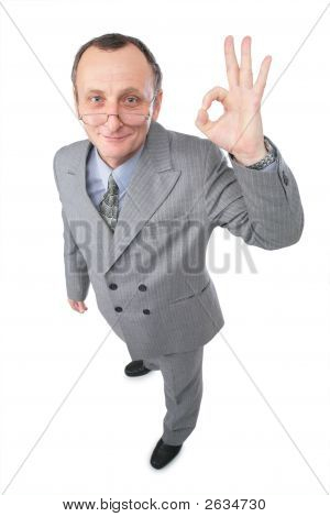 Man In Grey Suit Gives Gesture Ok