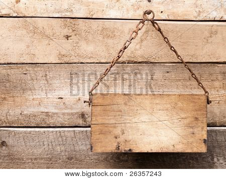 Wood signboard on metal chain