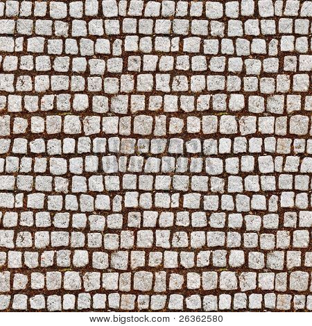 Cobblestone sidewalk made of cubic stones - tileable texture