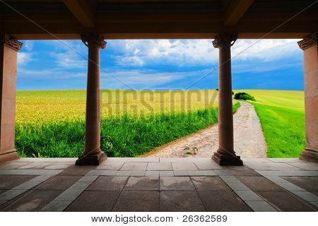 Road in field  look from old arcitecture construction