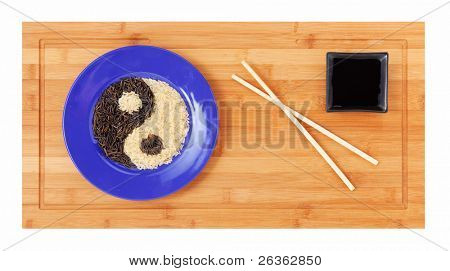 Dish of wild  and white rice,  yin yang symbol