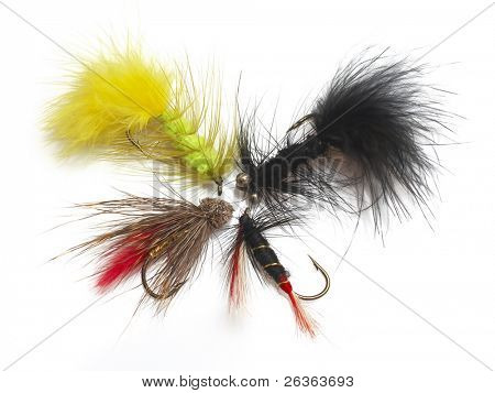handmade fly fishing hooks isolated over a white background