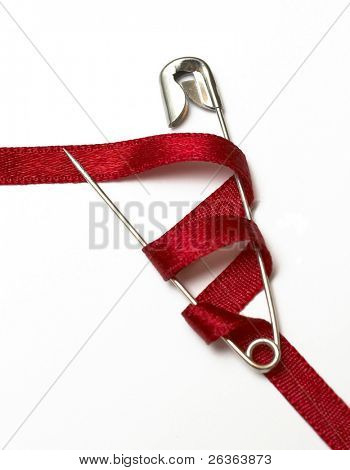 safety pin and red ribbon