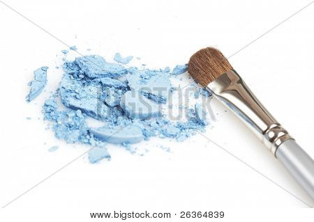 blue glittering eyeshadow and silver brush