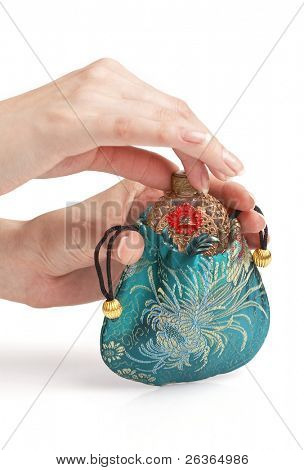 woman hands on vintage perfume bottle