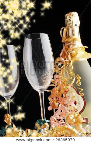 Champagne and glasses on glittering background