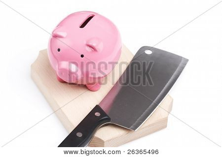 piggy bank and kitchen knife, extreme savings reduction concept,