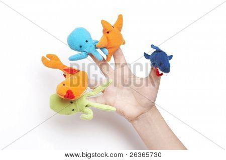 child's hand playing with finger puppets