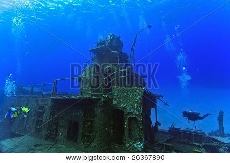Divers exploring a shipwreck