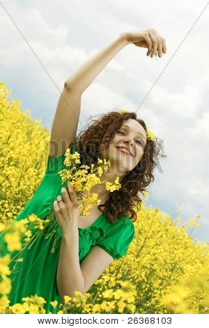 girl having fun in summer rapeseed (canola) field
