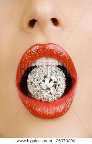 diamond between beautiful red lips