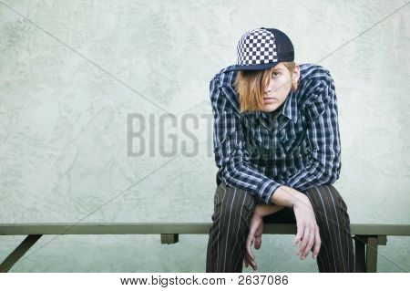 Teenage Boy On A Bench