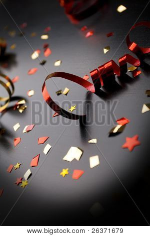 Holiday background, red ribbon on black