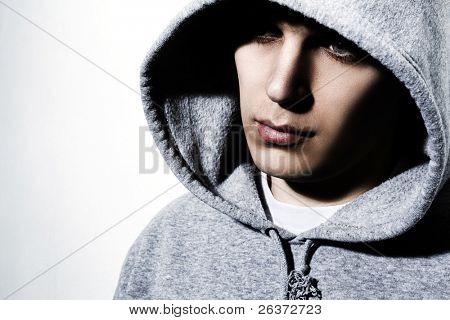 young man wearing hooded sweatshirt