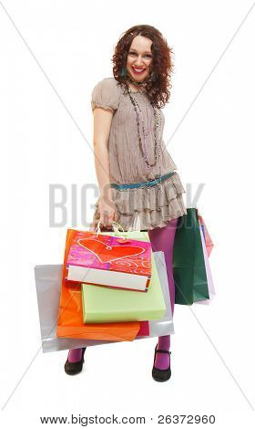 happy young girl with many shopping bags