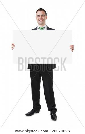 businessman holding big white card