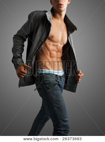 dynamic studio shot of a young fashion male model