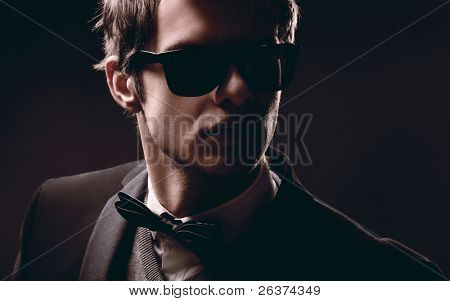 Closeup portrait of an elegant fashion man wearing sunglasses