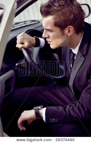 young businessman in his car