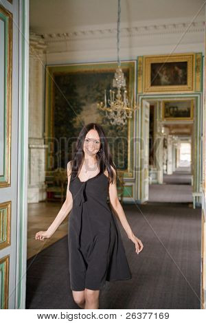 Happy beautiful woman walking in her mansion house