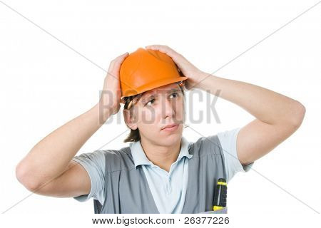 Construction worker holding on his head in his arms. Isolated. Image with clipping path.
