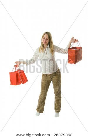 young smiling pregnant woman with paper bags after shopping
