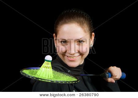 A picture of a girl holding a badminton racket with a shuttlecock on it
