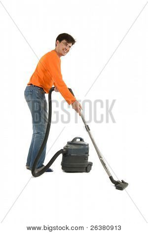 One adult man is hoovering, smiling to the camera.