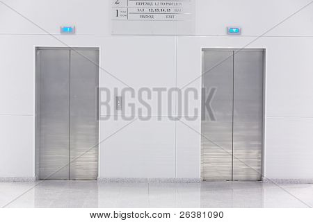 Two doors of elevators in modern business building