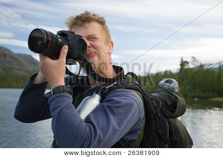 Tourist taking pictures of mountains and wriggle