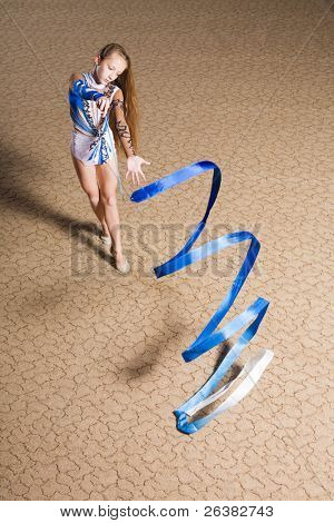 12 years old girl doing rhythmic gymnastics