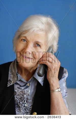 Senior Woman Busy By Telephone Call