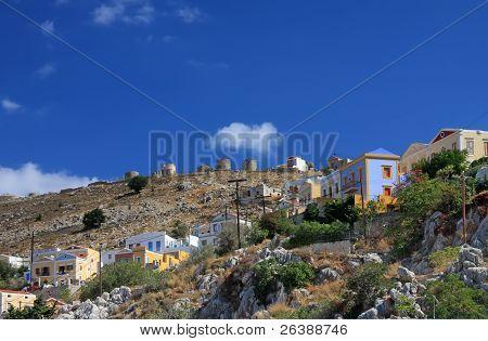 Greece. Dodecanesse. Island Symi (Simi). Colorful houses on rocks