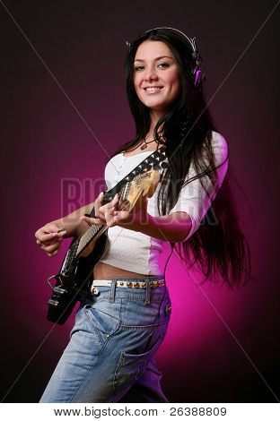 happy smiling teen playing guitar