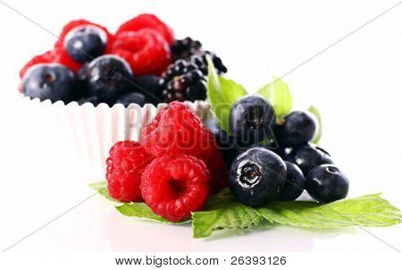 Fresh raspberry, dewberry and blueberry over white background