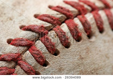 baseball macro abstract with shallow depth of field and focus near the bottom left corner