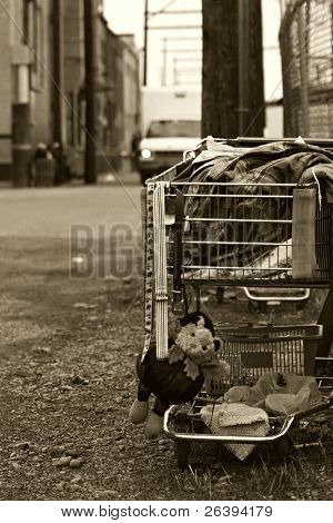 shopping cart of a homeless individual with a stuffed animal dangling from the front. converted with added grain.