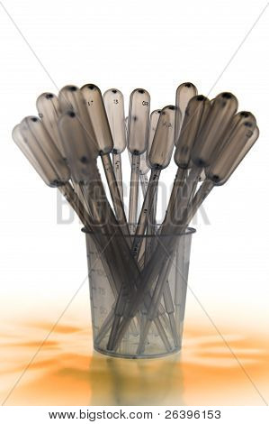 Shaded Pipettes Standing Placed In Measure Glass