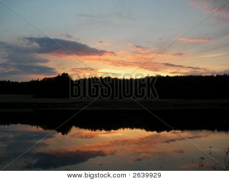 Sunset And Calm Lake