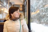 Woman Looking Out Of The Window Of Train During Travel On Cogwheel Railway/rack Railway In Alps Moun poster