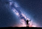 Milky Way And Silhouette Of A Standing Happy Man With Raised Up Arms. Travel In Nepal. Landscape Wit poster