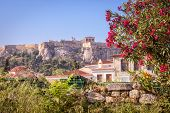 Ancient Greek Ruins With Flowers Overlooking The Acropolis, Athens, Greece. Famous Acropolis Is The  poster